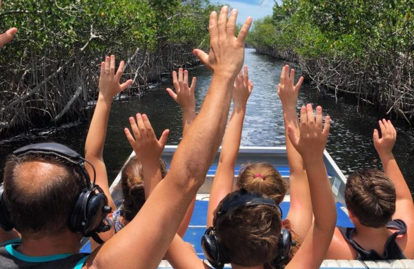 Everglades City Airboat with family raising hands