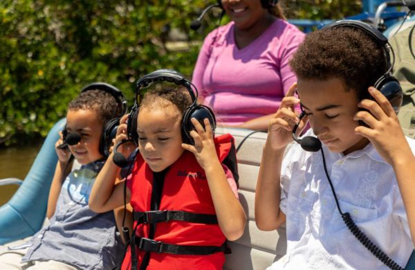 Kids putting headsets on Everglades City Airboat Tours