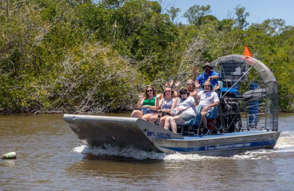 Everglades City Airboat with family waving at the camera
