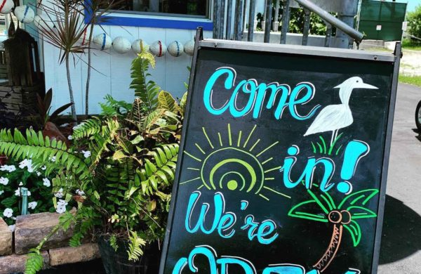 """Everglades City Airboat Tours signage """"We're Open for Business""""s"""