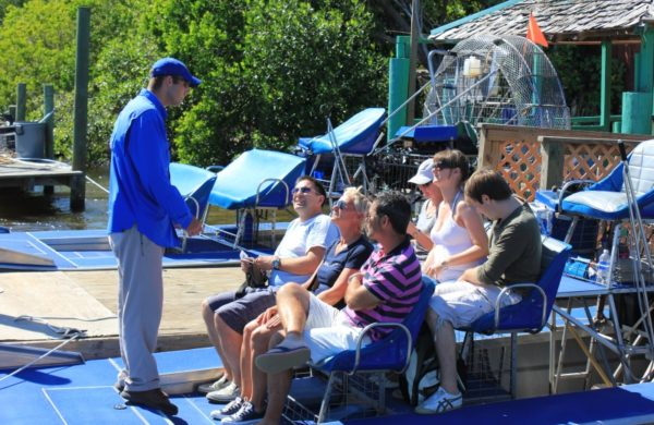 An Everglades City Airboat Tours guide giving instructions to tourists