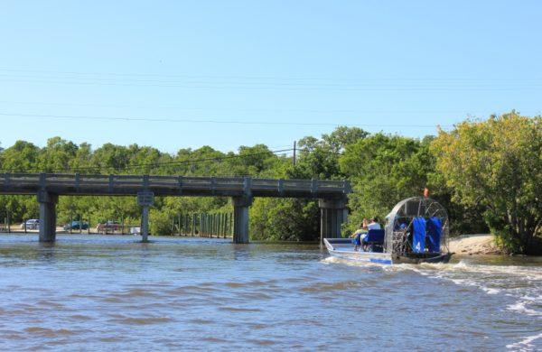 Everglades City Airboat Tours cruising through a bridge