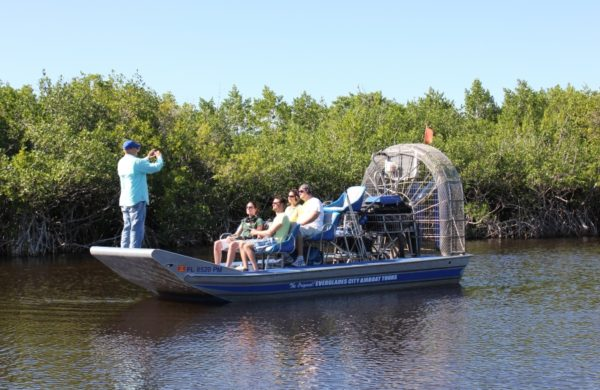 An Everglades City Airboat Tours guide taking a picture of tourists